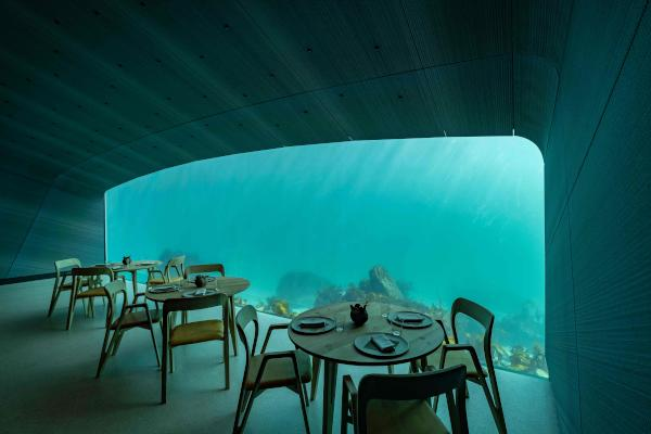 Interior view of a restaurant named Under, that is semi-submerged beneath the waters of the North Atlantic in Lindesnes near Kristiansand, some 400 km south west of Oslo, pictured on March 19, 2019. (Photo by Tor Erik SCHRODER / NTB Scanpix / AFP)/ Norway