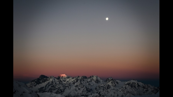 Morning light rises over Mont Blanc from the Swiss alpine resort of Verbier  AFP / Fabrice COFFRINI