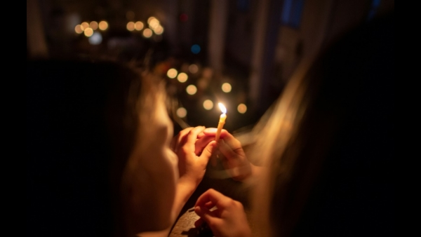 Girls light up candles as they celebrate Easter Vigil in Bratislava, Slovakia - AFP / JOE KLAMAR
