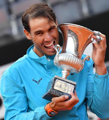Rafael Nadal of Spain poses with his trophy after defeating Novak Djokovic of Serbia in their men's singles final match at the Italian Open tennis tournament in Rome, Italy, 19 May 2019. EPA/ETTORE FERRARI