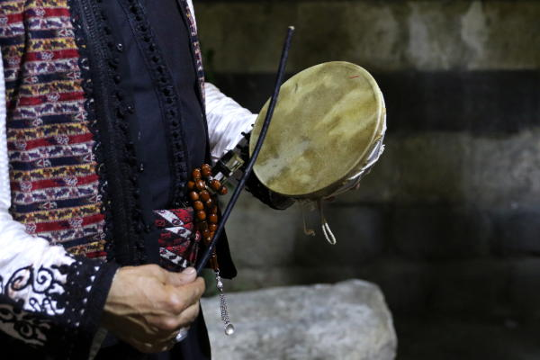 A Mesaharati (The one who announces Suhor time, the meal before starting the fast, a traditional job related to Ramadan) walks and knocks on his small drum through the old city street in Damascus, Syria, 21 May 2019. EPA/YOUSSEF BADAWI