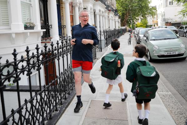 Britain's Environment, Food and Rural Affairs Secretary Michael Gove jogs in London on June 18, 2019. (AFP)
