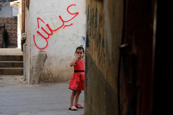 A Palestinian girl looks on at al-Fari'ah refugee camp in the Israeli-occupied West Bank June 23, 2019. Picture taken June 23, 2019. REUTERS/Raneen Sawafta