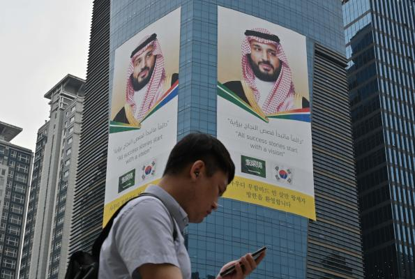 Huge banners showing a portrait of Saudi Arabia's Crown Prince Mohammed bin Salman are seen on the wall of the S-Oil headquarters building in Seoul on June 26, 2019. (Photo by Jung Yeon-je / AFP)