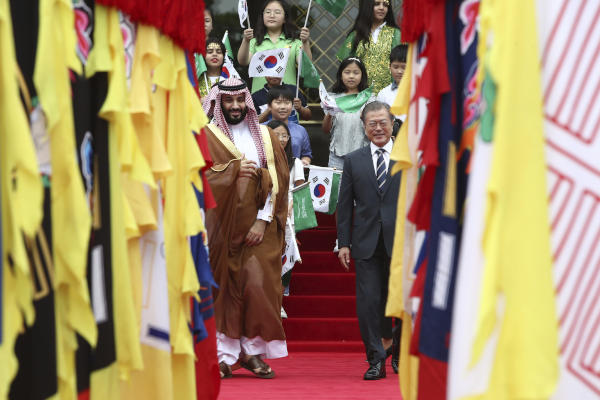 Saudi Crown Prince Mohammed bin Salman and South Korean President Moon Jae-in view an honor guard during a welcoming ceremony at the presidential Blue House, Wednesday, June 26, 2019, in Seoul, South Korea.(Chung Sung-Jun/Pool Photo via AP)