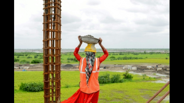 A labourer looks on as he works at a construction site of the upcoming Dholera Industrial City, at Dholera some 110 kms from Ahmedabad  AFO/AFP / SAM PANTHAKY