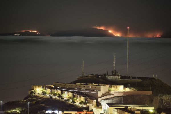 The fire on the mountains of the Canary Islands in this view taken from Santa Cruz de Tenerife island, Spain, early Monday, Aug. 19, 2019. (AP)