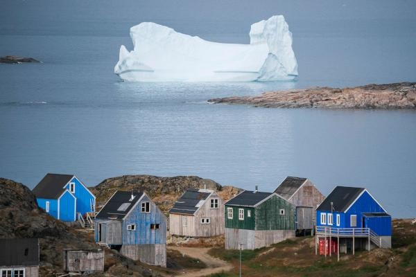 Icebergs float behind the town of Kulusuk in Greenland on August 19, 2019. (AFP)