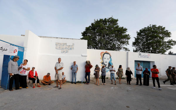 People wait to cast their vote outside a polling station during presidential election in Tunis, Tunisia, September 15, 2019. (Reuters)