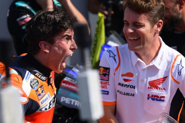Repsol Honda Team Spanish rider, Marc Marquez (L) celebrates after winning the San Marino MotoGP Grand Prix race at the Misano World Circuit Marco Simoncelli on September 15, 2019. (AFP)