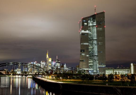 The European Central Bank stands next the buildings of the banking district in Frankfurt, Germany, Tuesday, Sept. 17, 2019. (AP Photo/Michael Probst)