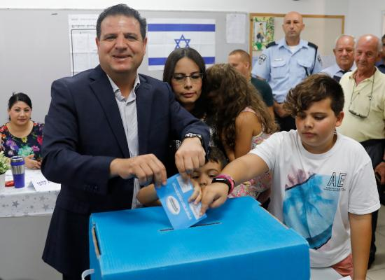 Israel's head of the mainly Arab Joint List alliance Ayman Odeh casts his ballot accompanied by his family during Israel's parliamentary election at a polling station in Haifa on September 17, 2019. (Photo by Ahmad GHARABLI / AFP)