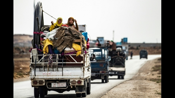 Families fleeing from Darbasiyah, northern Syria  AFP / Delil SOULEIMAN