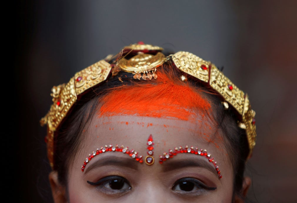 A girl from the Newar community wears vermillion powder on her forehead as she takes part in the Ihi ceremony, which culminates in her father giving her away to her future husband, Bhaktapur, Nepal. (Reuters)