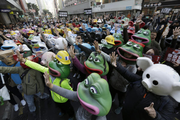 Pro-democracy protesters march on a street during a protest in Hong Kong, Sunday, Dec. 8, 2019. (AP)