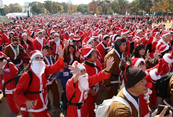 Thousands of people dressed as Santa Claus gather for the annual Osaka Great Santa Run at Osaka Castle Park in Osaka, Japan, 08 December 2019. (EPA)