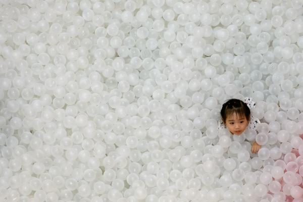 A child plays in a pool full of plastic balls at a Christmas-themed playground in Bangkok on December 15, 2019. (AFP)