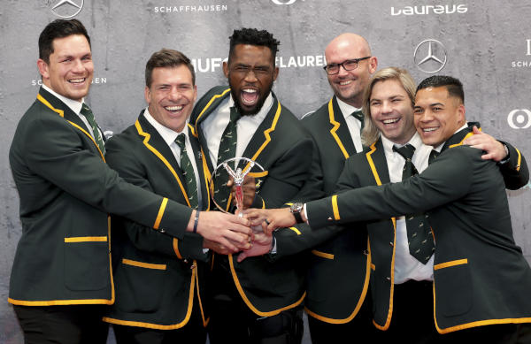 Players of South Africa's Men's Rugby team pose with the 'Team of the Year Award' during the 2020 Laureus World Sports Awards in Berlin, Germany, Monday, Feb. 17, 2020. (AP)