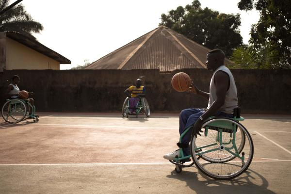 Wheelchair basketball players warm up on a basketball court in Bangui, on January 24, 2020. (Photo by FLORENT VERGNES / AFP)