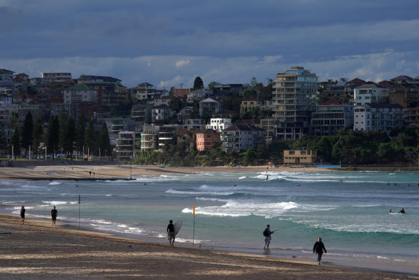 People are seen at Manly Beach following the implementation of stricter social-distancing and self-isolation rules to limit the spread of the coronavirus disease (COVID-19), in the Manly suburb of Sydney, Australia April 6, 2020. REUTERS/Loren Elliott