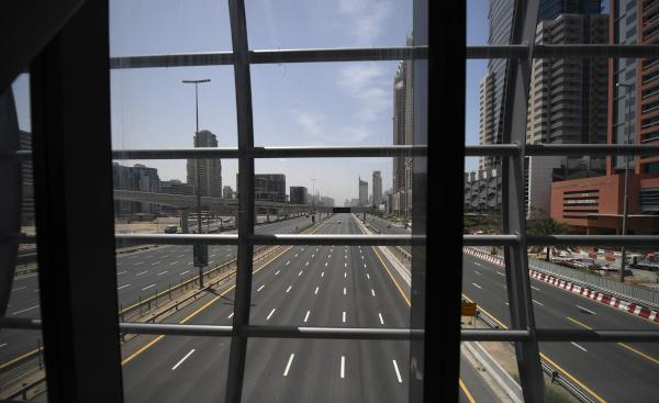 Dubai's Sheikh Zayed road is deserted during a curfew imposed by the authorities in a bid to slow down the spread of the novel coronavirus in the Emirati city on April 5, 2020. (Photo by KARIM SAHIB / AFP)