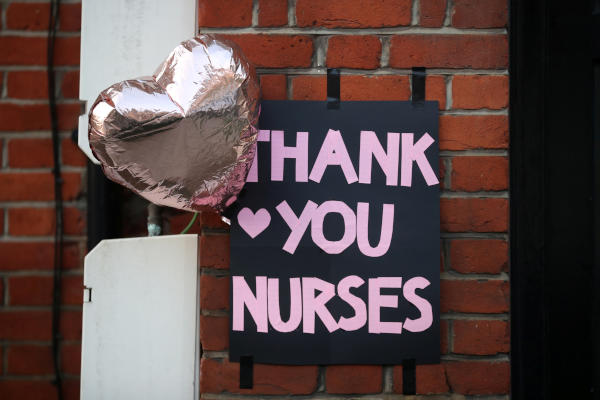 A sign thanking nurses is seen near King's College Hospital, as the spread of the coronavirus disease (COVID-19) continues, in London, Britain April 9, 2020. REUTERS/Hannah McKay