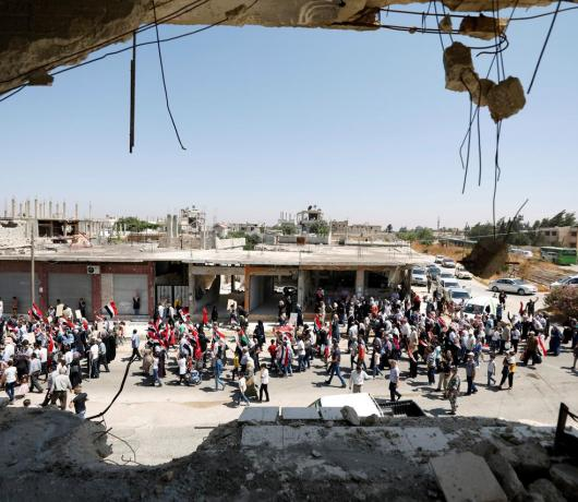 Exclusive - Syrian Refugees Trickle Back to Qusayr under Watchful Eyes of the Regime, Hezbollah