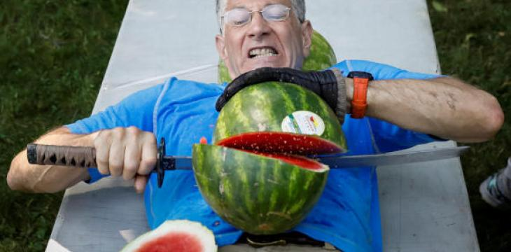 Man Sets Record for Slicing Most Watermelons in Half on His Stomach