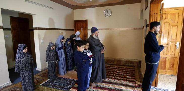 Gaza Family Holds Friday Prayers at Home