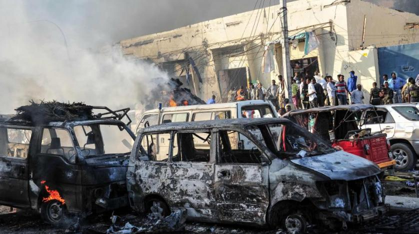 Burnt out cars following a truck bomb in Somalia. AFP file