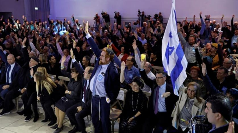 Party members vote during the Likud Central Committee meeting
