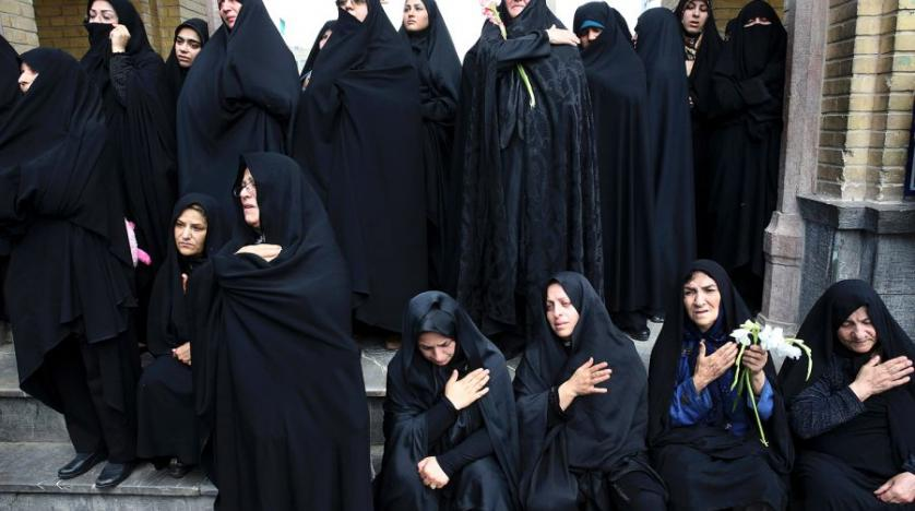 Iranian women mourn during the funeral ceremony of two fighters killed in Syria in southern Tehran Iran