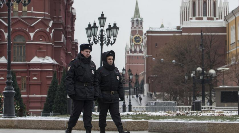 Russian police officers patrol the Manezh Square at the Kremlin in Moscow Russia