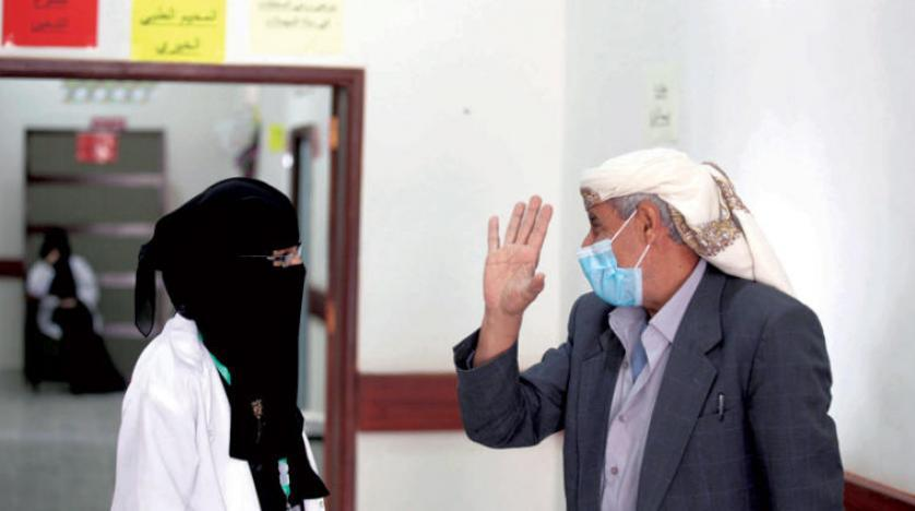 A Yemeni speaks to a volunteer nurse in a health center offering free medical services to needy people in Sanaa