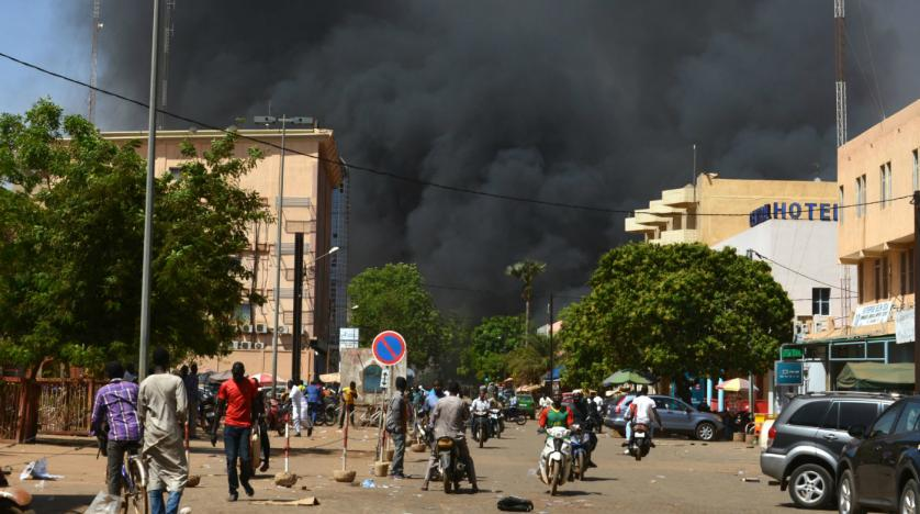 Black smoke billows above downtown Ouagadougou. Ahmed Ouoba  AFP