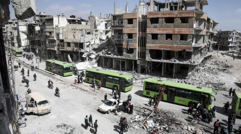 Syrian state media: last rebel group starts leaving Ghouta