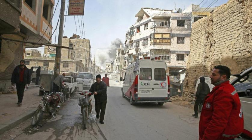Smoke rises during evacuation in the besieged town of Douma Eastern Ghouta in Damascus Syria