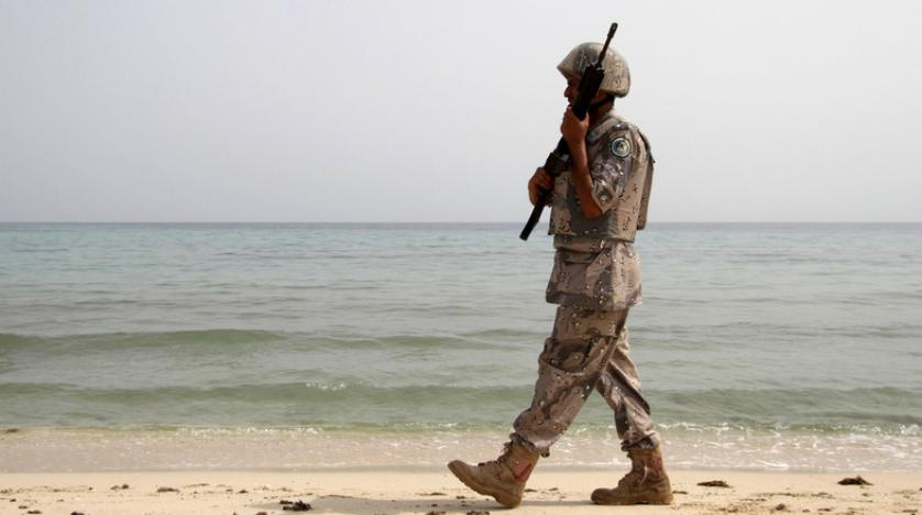A Saudi border guard patrols near Saudi Arabia's border with Yemen along the beach on the Red Sea near Jizan