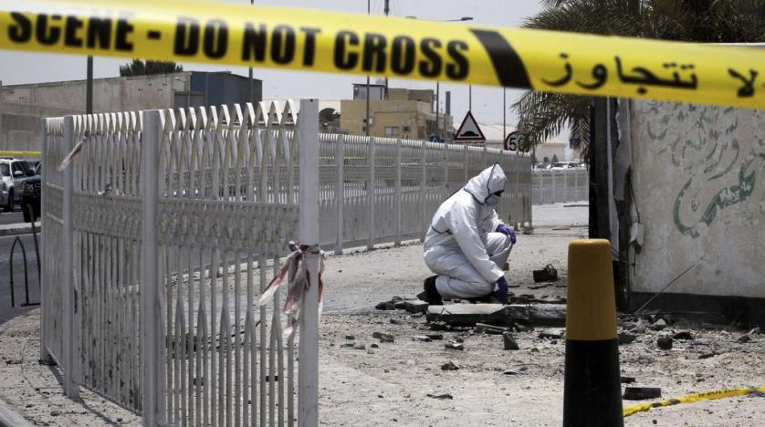 A Bahraini forensic police officer inspects the site of a bomb blast in the village of Sitra south of Manama in 2017