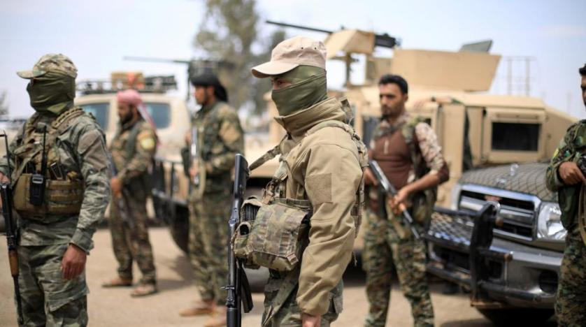 Fighters of Syrian Democratic Forces are seen in Deir Ezzor Syria