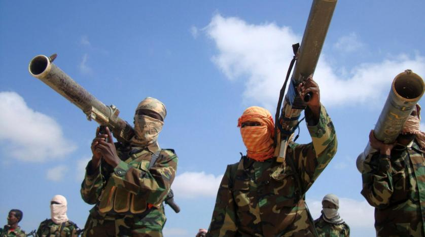Members of Somalia's al Qaeda linked al Shabaab hold their weapons in Mogadishu Somalia