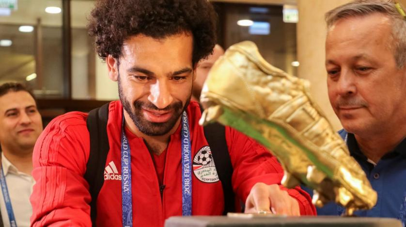 Mohamed Salah needed help to pull on jersey over injured shoulder
