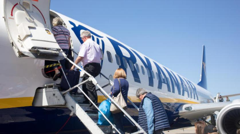 Passengers board a Ryanair Holdings flight at Dublin Airport in Ireland