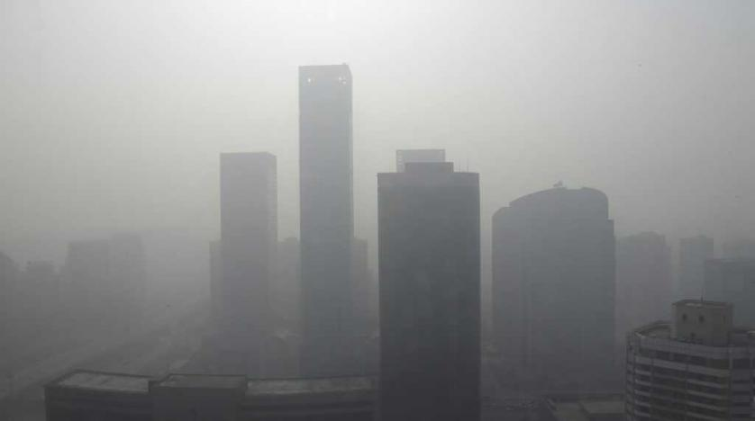 Buildings are seen in heavy haze in Beijing's central business district