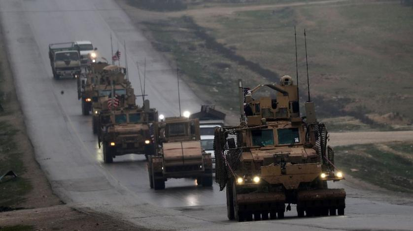 30 2018 shows a convoy of US military vehicles driving through Syria's northern city of Manbij | AFP