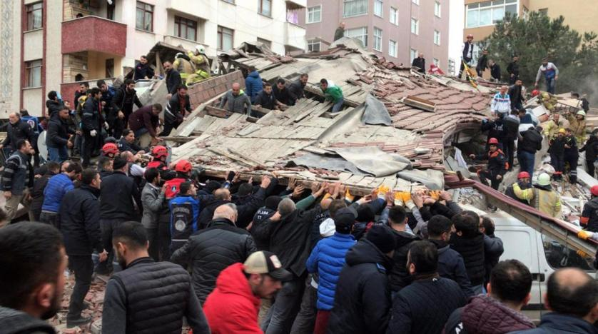 Rescuers at the collapsed building in Istanbul. AP