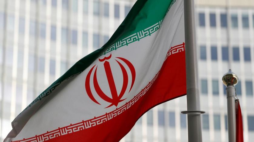 An Iranian flag in front the International Atomic Energy Agency headquarters in Vienna Austria
