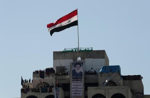Iraq Protesters Unfurl UN Flag to Appeal for Protection
